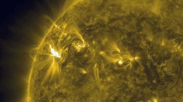An image released by NASA on March 5, 2012 is a view of a X1 solar flare in a new active region on the sun, region 1429. It has let loose two M-class flares and one X-class so far. The M-class flares erupted on March 2 and on March 4. The third flare, rated an X1, peaked at 10:30 ET on March 4. A CME accompanied each flare, though due to the fact that this active region is still off to the side of the sun, they will likely have a weak effect on Earth's magnetosphere.  (AP Photo/NASA)
