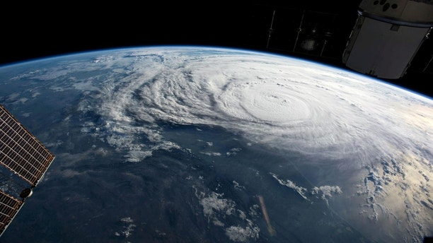 Hurricane Harvey is pictured off the coast of Texas, U.S. from aboard the International Space Station in this August 25, 2017 NASA handout photo. To match Special Report USA-FLOODS/INSURANCE  NASA/Handout via REUTERS    ATTENTION EDITORS - THIS IMAGE WAS PROVIDED BY A THIRD PARTY. THIS PICTURE WAS PROCESSED BY REUTERS TO ENHANCE QUALITY. - RC17A3AD9290