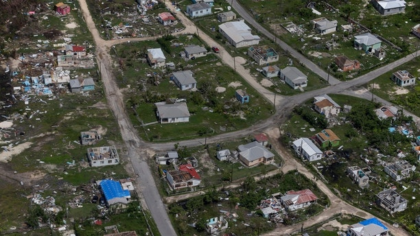 Houses are seen in ruins in Codrington on the island of Barbuda just after a month after Hurricane Irma struck the Caribbean islands of Antigua and Barbuda, October 7, 2017. Picture taken October 7, 2017. REUTERS/Shannon Stapleton - RC1BBA7B6E10