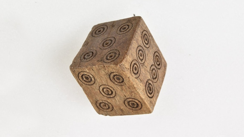 The apparently loaded dice have two fives and two fours, instead of the numbers one and two.
