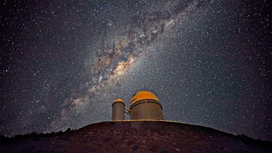 The Milky Way stretches across the sky above the La Silla telescope in Chile. Trillions of planets lurk in our galaxy, many of which have not yet been found.