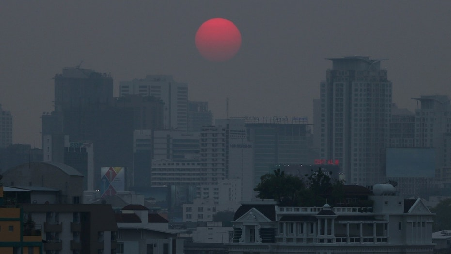 The sun is seen through evening air pollution in Bangkok, Thailand, Feb. 8, 2018.