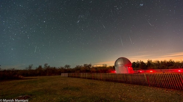 The Geminid meteor shower peaks Sunday (Dec. 13) and Monday (Dec. 14), 2015. Shown here, astrophotographer Manish Mamtani caught this snapshot of the Geminid meteor shower over the Frosty Drew Observatory in Charlestown, Rhode Island in 2014.