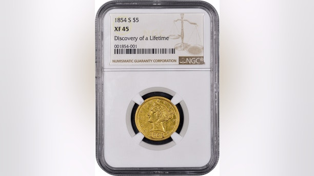 """Mistakenly believed by its anonymous New England owner to be a fake, this historic gold coin now has been authenticated as """"the discovery of a lifetime"""" by Numismatic Guaranty Corporation (www.NGCcoin.com) in Sarasota, Florida as only the fourth known surviving example of a $5 denomination coin struck at the San Francisco Mint during the California Gold Rush in 1854.  It is worth millions of dollars, according to NGC. Photos courtesy of Numismatic Guaranty Corporation www.NGCcoin.com. (PRNewsfoto/Numismatic Guaranty Corporation)"""