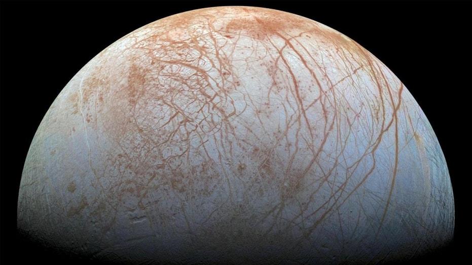 Europa's surface is a shell of ice covering a global ocean and displaying amazing features. Long, linear cracks and ridges crisscross the surface, broken by regions of disrupted terrain where the crust of surface ice has cracked and refrozen into new patterns. (Credit: NASA/JPL-Caltech)
