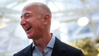 Amazon founder and CEO Jeff Bezos laughs as he talks to the media while touring the new Amazon Spheres during the grand opening at Amazon's Seattle headquarters in Seattle, Washington, U.S., January 29, 2018.   REUTERS/Lindsey Wasson - RC1DD03FA240