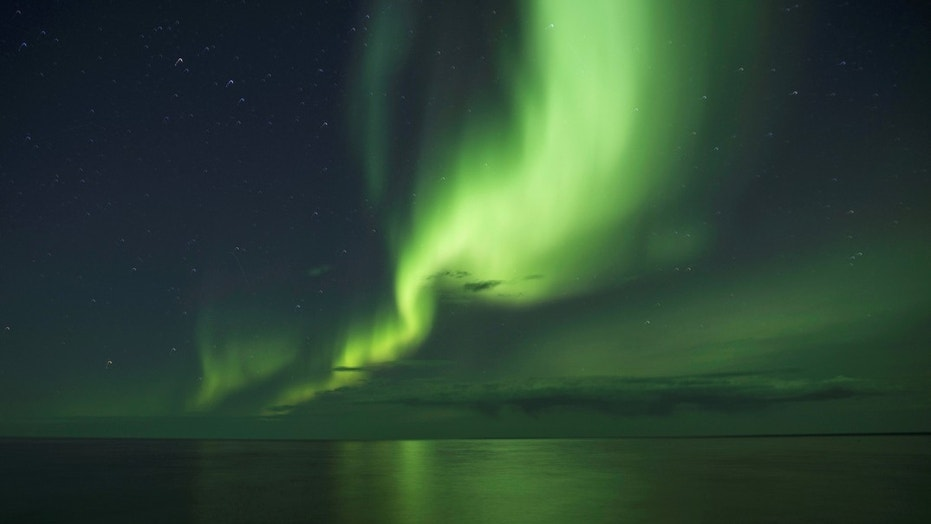 """Northern lights are caused by """"collisions between fast-moving particles (electrons) from space"""" an Earth's atmosphere."""