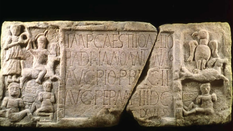 The Summerston distance slab from the western end of the Roman Antonine Wall in Scotland was once brightly painted in warning reds, yellow and white. Credit: Hunterian Museum/University of Glasgow