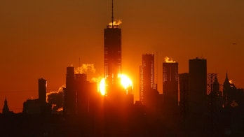 KEARNY, NJ - JANUARY 7: The sun rises behind the skyline of lower Manhattan and One World Trade Center in New York City on January 7, 2018, as seen from Kearny, New Jersey. (Photo by Gary Hershorn/Corbis via Getty Images)