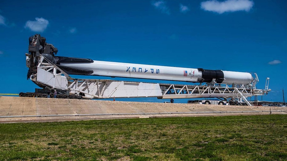 SpaceX's first Falcon 9 Block 5 rocket rolls to its launch pad at NASA's Kennedy Space Center in Florida.