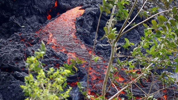 Lava erupts from a fissure east of the Leilani Estates subdivision during ongoing eruptions of the Kilauea Volcano in Hawaii, U.S., May 12, 2018.  REUTERS/Terray Sylvester - RC16CCC37E20