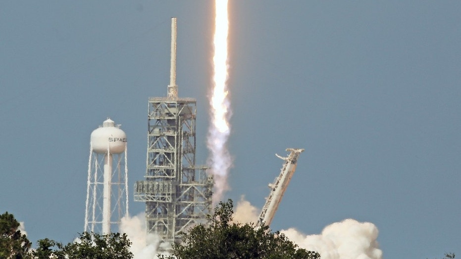 An upgraded version of the SpaceX Falcon 9 Block 5 rocket lifts off Friday, May 11, 2018 from launch pad 39A at the Kennedy Space Center carrying Bangladesh's first communications satellite. The $250 million satellite, the nation's first, is designed to improve television, telephone, data, Internet and emergency communications for Bangladesh. (Red Huber /Orlando Sentinel via AP)