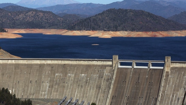 Shasta Lake, which is 100 feet (30 meters) below its customary ranges, is shown in the aid of Shasta Dam with Mount Shasta in background  in Shasta, California January 23, 2014. California Governor Jerry Brown final week declared a drought emergency, and the dry 300 and sixty five days of 2013 has left unusual water reservoirs with a allotment of their customary water reserves. Advise taken January 23, 2014.  REUTERS/Robert Galbraith (UNITED STATES - Tags: ENVIRONMENT) - GM1EA1P0B4K01