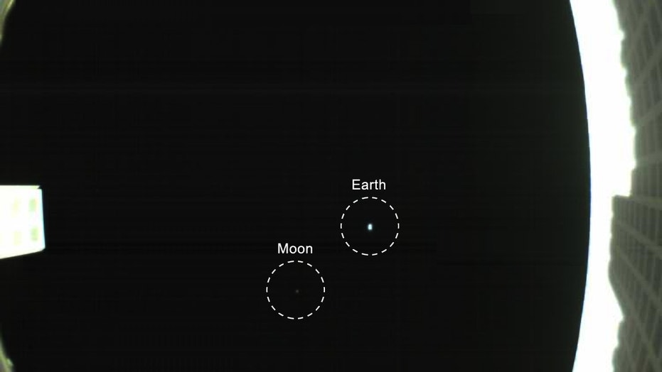 The Earth and moon star in this first photo from Wall-E, one of NASA's two Mars Cube One cubesats, that launched with the agency's InSight Mars lander on May 5, 2018. This view of Earth and the moon was taken May 9.