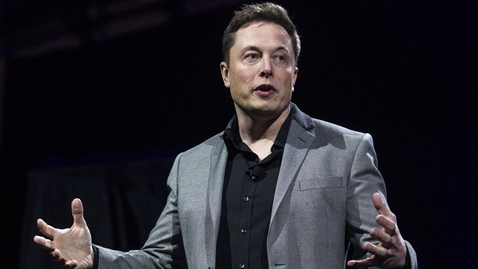 FILE - In this April 30, 2015, file photo, Tesla Motors CEO Elon Musk unveils the company's newest products, in Hawthorne, Calif. (AP Photo/Ringo H.W. Chiu, File)