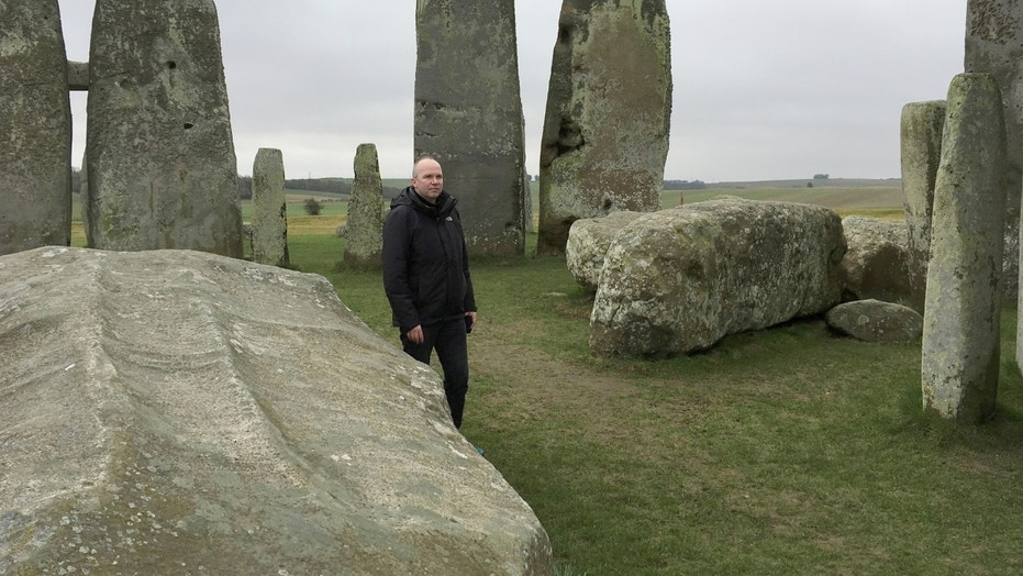 File photo: Doctor Rupert Till, music technologist from the University of Huddersfield, poses for a photograph in the stone circle of the ancient monument of Stonehenge, Amesbury, Britain February 22, 2017.  (REUTERS/Matthew Stock)