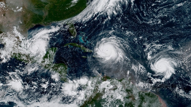 Hurricane Irma, Hurricane Jose (R) and Hurricane Katia (L) are pictured  in the Atlantic Ocean in this September 7, 2017 NOAA satellite handout photo. NOAA/Handout via REUTERS    ATTENTION EDITORS - THIS IMAGE WAS PROVIDED BY A THIRD PARTY. - RC15EDE3F130