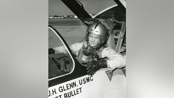 """Photograph of John Glenn in the cockpit his F8U-1P Crusader during the """"Project Bullet"""" record breaking transcontinental flight, 1957"""