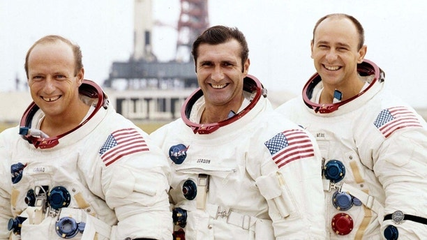"- UNDATED FILE PHOTO - The crew for the Apollo 12 manned lunar landing mission, from left; Charles "" Pete"" Conrad, Jr., Richard F. Gordon, and Alan L. Bean, stand near their launch vehicle in this undated file photo. [Conrad, the third man to walk on the moon, died July 8 in Ojai, California at the age of 69 from injuries resulting from crashing his Harley-Davidson motorcycle.] - PBEAHULTCDN"
