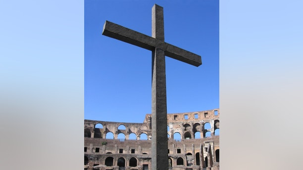 A cross at one of the arched entrances to the Roman Colosseum.  The Romans executed many Christians at similar sites throughout Rome.