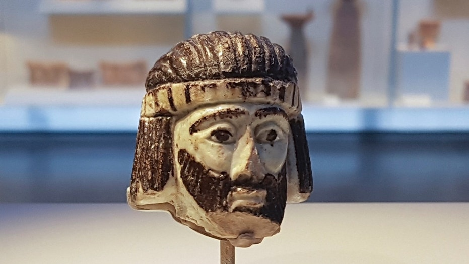 This photo shows a detailed figurine of a king's head on display at the Israel Museum, dating to biblical times, and found last year near Israel's northern border with Lebanon, in Jerusalem.