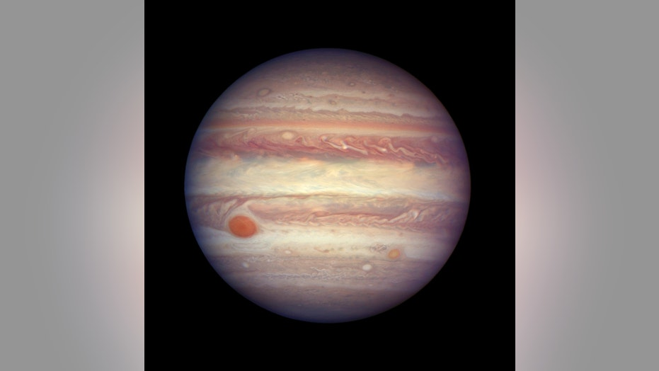 FILE - This April 3, 2017 file image made available by NASA shows the planet Jupiter when it was at a distance of about 668 million kilometers (415 million miles) from Earth. (NASA, ESA, and A. Simon (GSFC) via AP, File)