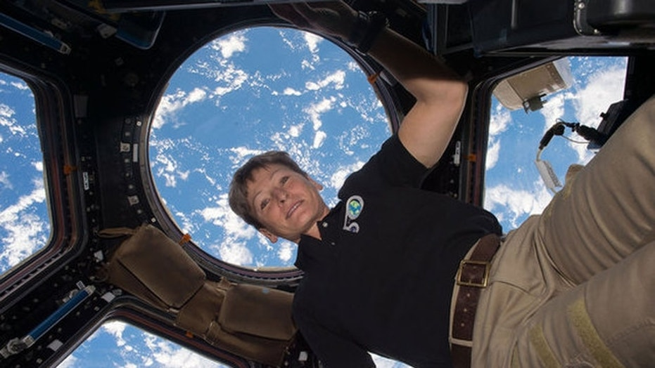 Peggy Whitson floats in the Cupola aboard the International Space Station. The record-setting NASA astronaut retired from the space agency on June 15, 2018.