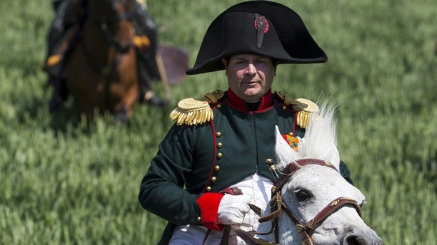 Frenchman Frank Samson takes part in the re-enactment of the battle of Ligny, as French Emperor Napoleon, during the bicentennial celebrations for the Battle of Waterloo, in Ligny, Belgium, June 14, 2015.
