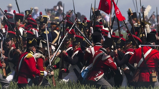 Performers take part in the re-enactment of the battle of Ligny, during the bicentennial celebrations for the Battle of Waterloo, in Ligny, Belgium, June 14, 2015.
