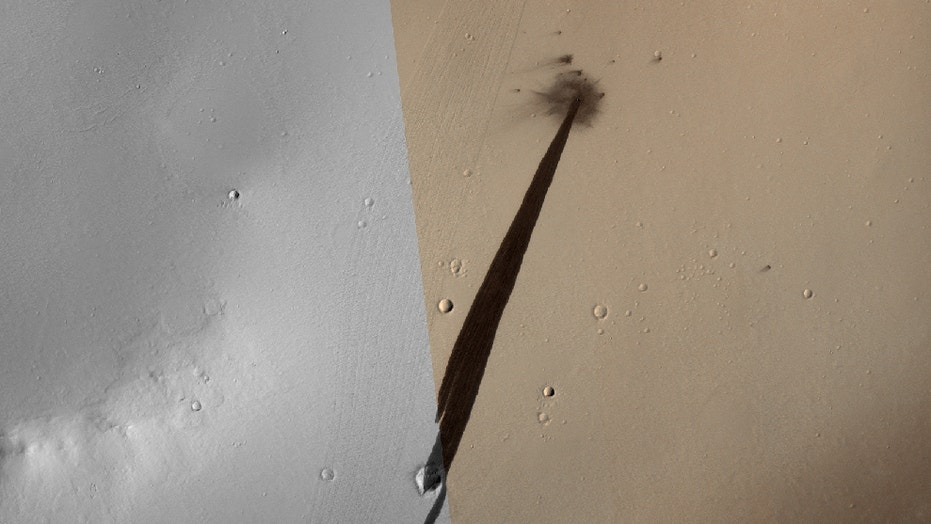 This small meteoroid impact on Mars within the last 10 years created this crater seen by NASA's Mars Reconnaissance Orbiter. The long, dark trail streaking down a slope to the lower left was caused by an avalanche triggered by the impact. NASA released this image on June 15, 2018.