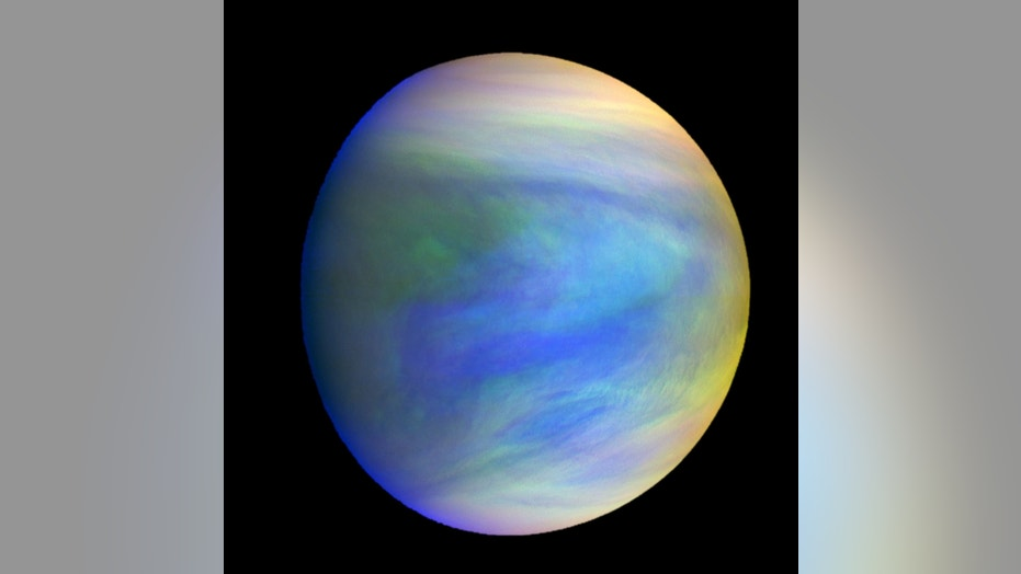 A composite image of Venus as seen by Japan's Akatsuki spacecraft. Venus' spin varies because of atmospheric waves over the planet's mountains, according to a new study.