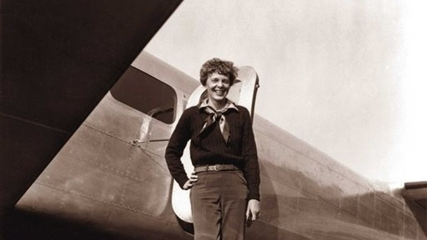 In this May 20, 1937 photo, provided by The Paragon Agency,shows aviator Amelia Earhart and her Electra plane, taken by Albert Bresnik at Burbank Airport in Burbank, Calif. It was a clear spring day in 1937 when Amelia Earhart, ready to make history by flying around the world, brought her personal photographer to a small Southern California airport to document the journey's beginning. (Albert Bresnik/The Paragon Agency via AP)