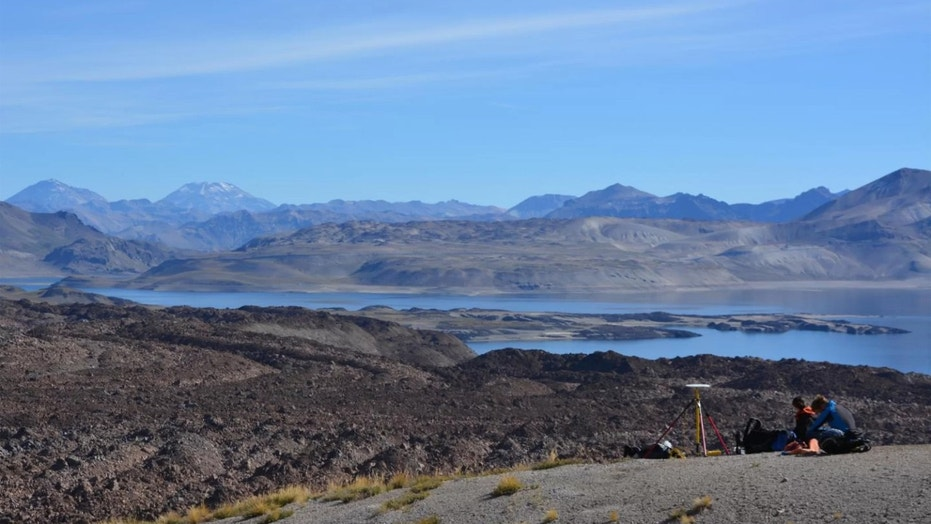 Scientists set up a GPS station to measure the altitude of the ancient shoreline of Laguna del Maule in Chile. Credit: Brad Singer