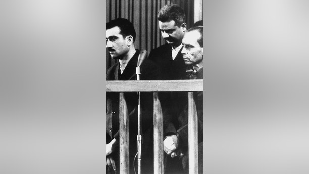DAMASCUS, SYRIA:  Picture dated 09 May 1965 shows Israeli spy Elie Cohen (L) and two other unidentified co-defendants, during their trial in Damascus, ten days before his execution. Israel wants Syria to return Cohen's remains as a confidence-building gesture in the framework of the peace talks between the two countries which resumed last month after a nearly four-year break. (Photo credit should read AFP/Getty Images)