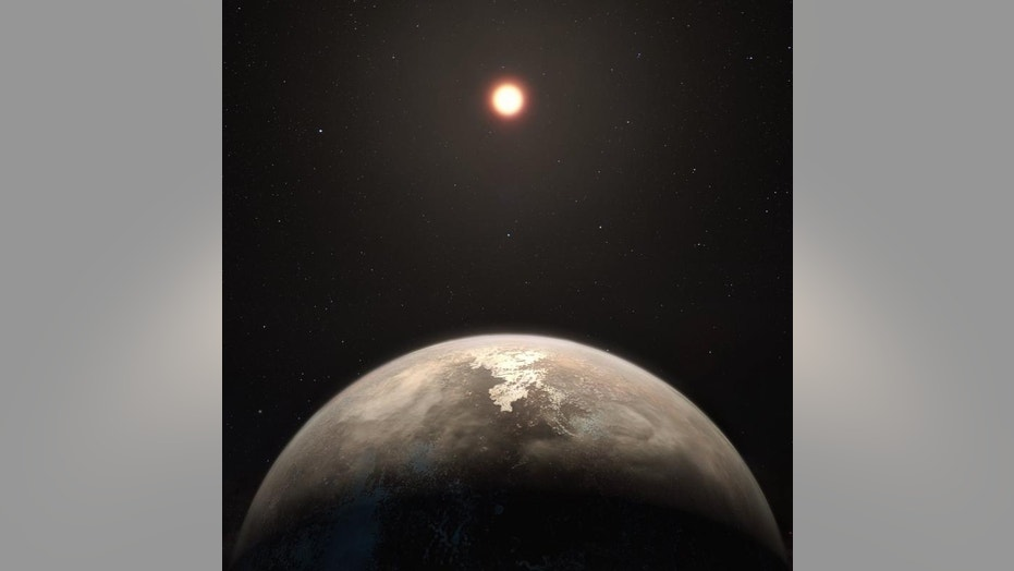 This artist's illustration shows the potentially temperate planet Ross 128b, with its red dwarf parent star in the background.
