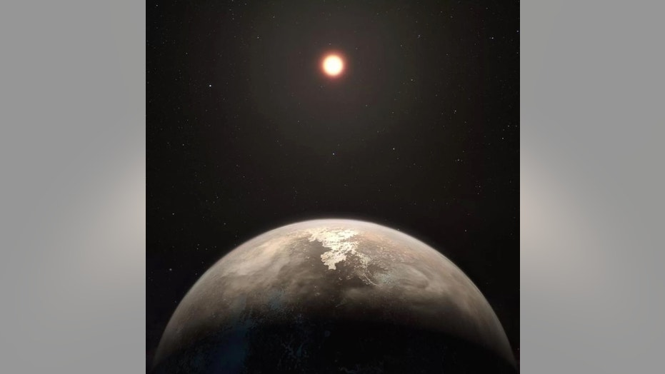 This artist's illustration shows the potentially temperate planet Ross 128b, with its red dwarf parent star in the background. Credit: M. Kornmesser/ESO