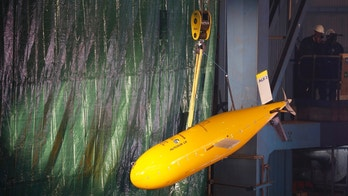 An unmanned submersible known as 'Boaty McBoatface' hangs from a crane during the keel laying ceremony of the new polar research vessel the Sir David Attenborough, at the Cammell Laird ship yard in Birkenhead, northern England October 17 , 2016. REUTERS/Phil Noble - RTX2P5D7