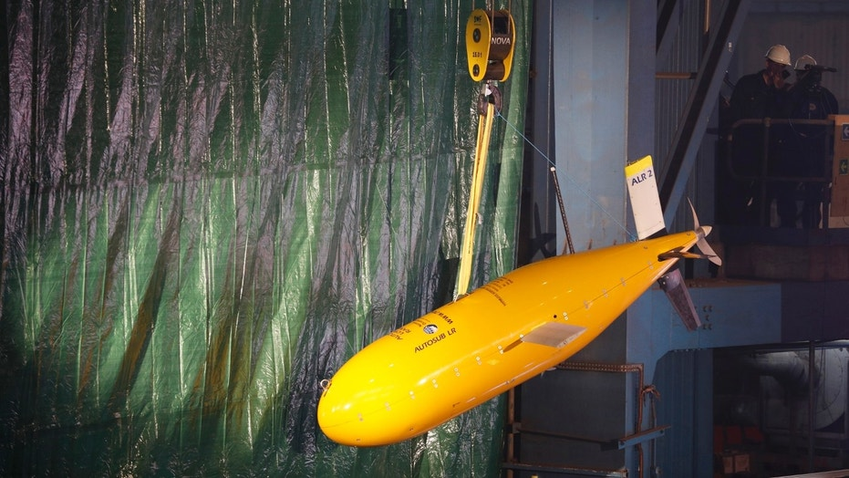 An unmanned submersible known as 'Boaty McBoatface' hangs from a crane during the keel laying ceremony of the new polar research vessel the Sir David Attenborough, at the Cammell Laird ship yard in Birkenhead, northern England, Oct. 17 , 2016.