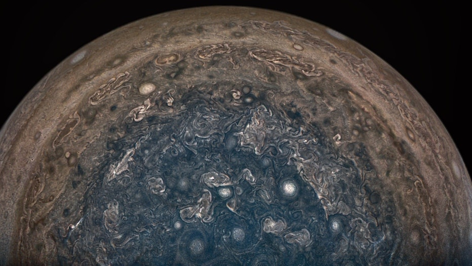 NASA's Juno spacecraft soared directly over Jupiter's south pole when JunoCam acquired this image on Feb. 2, 2017, from an altitude of about 62,800 miles (101,000 kilometers) above the cloud tops. This image was processed by citizen scientist John Landino. This enhanced color version highlights the bright high clouds and numerous meandering oval storms.