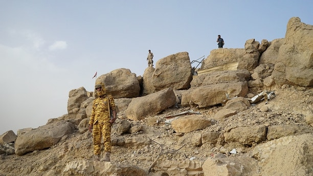 Soldiers standing guard near the Marib dam. The northern province, rich in oil, is largely under control of government forces and defended by their main military backers, a Saudi Arabia-led coalition that has several bases here. (Photo by Kareem Fahim/The Washington Post via Getty Images)