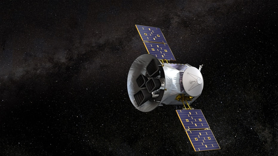 An artist's depiction of the TESS spacecraft in orbit around Earth.