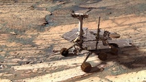 A digital model of the Opportunity rover added to a real image of the inside of Endurance Crater on Mars -- n earlier by Opportunity itself -- shows what the explorer would look like to a Martian observer.