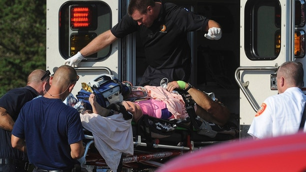 A man is transferred from a Truro ambulance to a MedFlight helicopter after being attacked by a shark, Wednesday, Aug. 15, 2018 in South Wellfleet, Mass. A man swimming off Cape Cod was attacked by a shark on Wednesday and was airlifted to a hospital. It was the first shark attack on a human on the popular summer tourist destination since 2012. (Merrily Cassidy