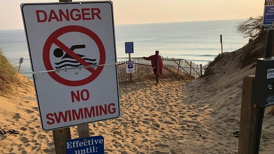 """Days after a shark attack in Massachusetts, the beach where the incident occurred was """"closed"""" off to swimmers for the foreseeable future """"due to continued shark activity,"""" the town announced Friday."""