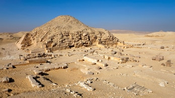 """The collapsed pyramid of Pharaoh Unas in Saqqara, including some ruins of tombs of the nobles. Unas was the last ruler of the Fifth dynasty from the Old Kingdom. He reigned approximately from 2375 BC to 2345 BC."""