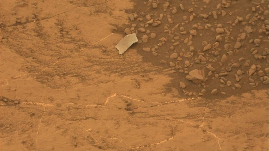 NASA's Mars rover Curiosity photographed this odd object on Aug. 13, 2018. Mission team members initially thought it might be a piece of the rover, but Curiosity's observations revealed it to be a rock flake.