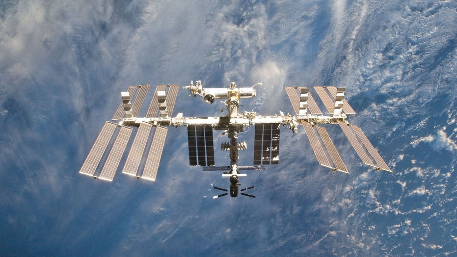 Space Station is seen in this view from the space shuttle Discovery after the undocking of the two spacecraft in this