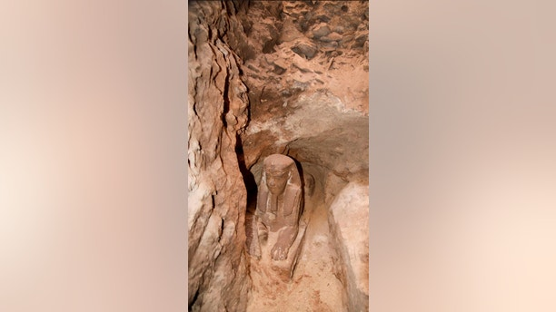 This undated photo released by the Egyptian Ministry of Antiquities, shows the latest discovery of a statue with a lion's body and a human head, in the Temple of Kom Ombo in Aswan, Egypt. The Antiquities Ministry said Sunday, Sept. 16, 2018 that the sphinx made of sandstone was found in the temple during work to protect the site from groundwater. (Egyptian Ministry of Antiquities via AP)