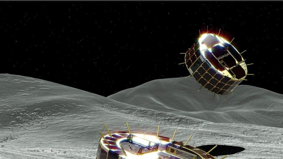 Japan lowers rovers onto 'dumpling' asteroid, hopeful of historic touchdown