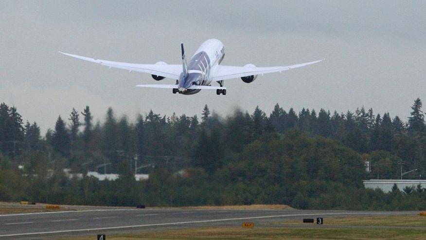 The first Boeing Co. 787 plane delivered to a commercial customer takes off for Japan, Tuesday, Sept. 27, 2011, in Everett, Wash. The plane will be operated by Japan's All Nippon Airways. (AP Photo/Ted S. Warren)